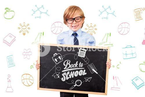 Composite image of cute pupil holding chalkboard