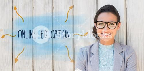 Online education against stylish brunette thinking and smiling
