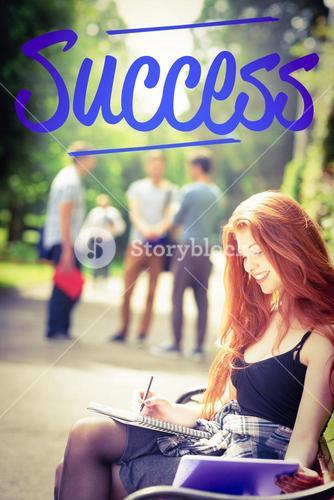 Success against pretty student studying outside on campus