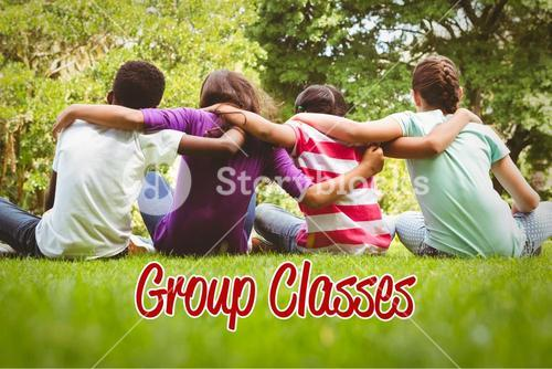 Group classes against children sitting with arms around at park