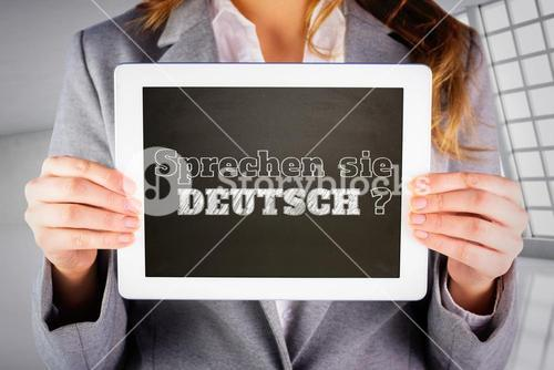Composite image of businesswoman showing tablet