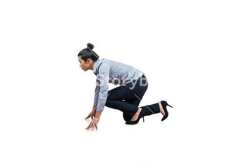 Woman in position for a run