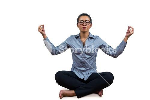 Woman meditating with her legs crossed