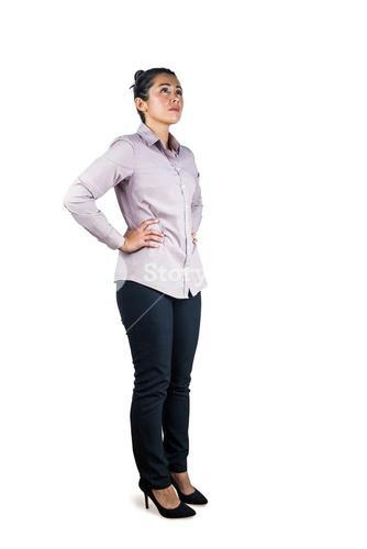 Businesswoman looking upwards with hands on hips
