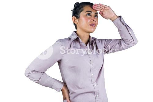 Businesswoman looking upwards with hands on head