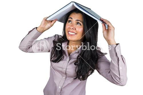 Businesswoman looking at a business ledger