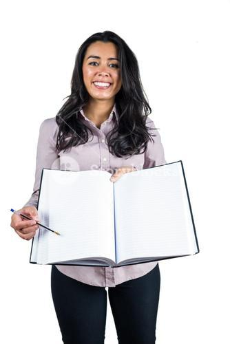 Businesswoman holding a business ledger and a pen