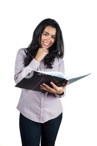 Businesswoman holding a business ledger