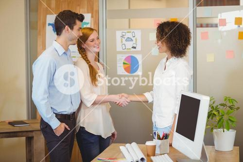 Business woman shaking hand with client