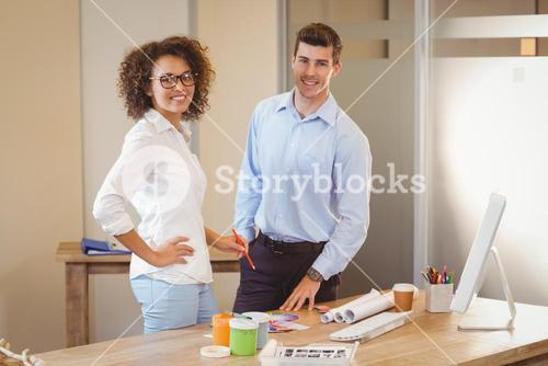Business people standing by table