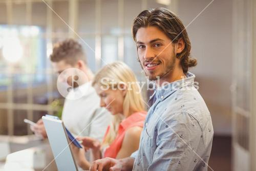 Businessman with colleagues working in office