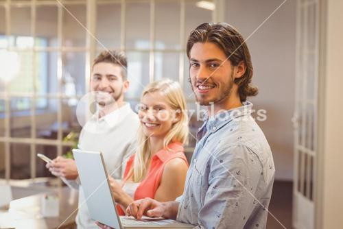 Portrait of happy business people working