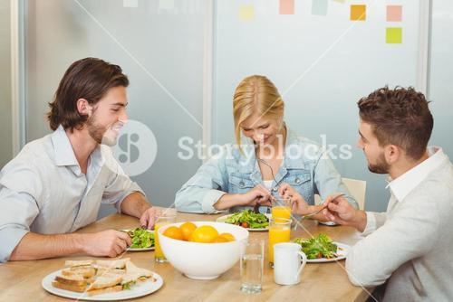 Business people having lunch in office