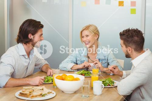 Business people laughing during lunch