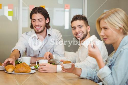 Businessman with colleagues having snacks