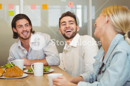 Business people laughing during brunch