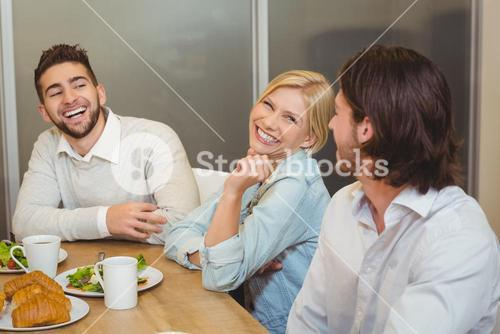 Business people enjoying brunch in canteen