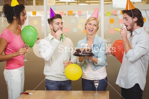 Colleagues enjoying birthday party