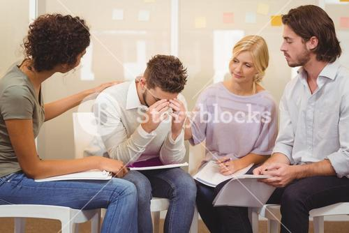 Stressed worker with her colleagues