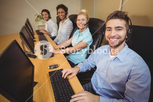 Portrait of smiling business people in call center