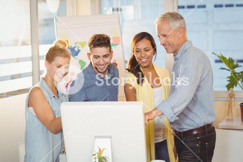 Business people using computer in meeting room