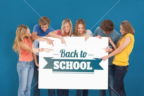 Composite image of a group holding a blank sheet and pointing to it