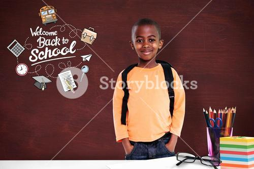 Composite image of cute elementary pupil smiling at camera