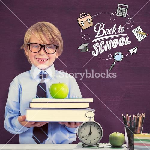 Composite image of cute pupil holding books and apple