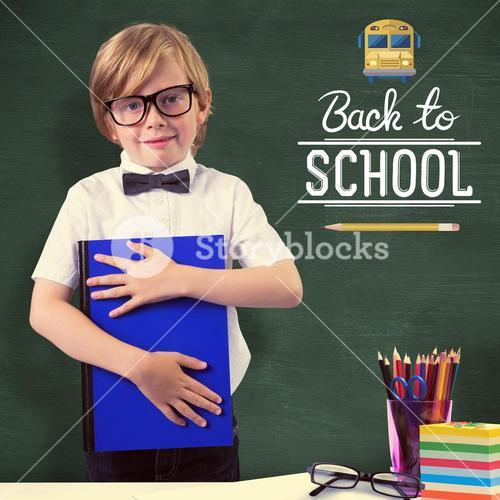 Composite image of cute pupil holding book