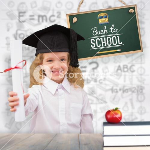Composite image of smiling schoolgirl with graduation cap and holding her diploma