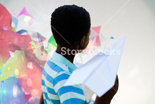 Composite image of cute little boy with paper airplane