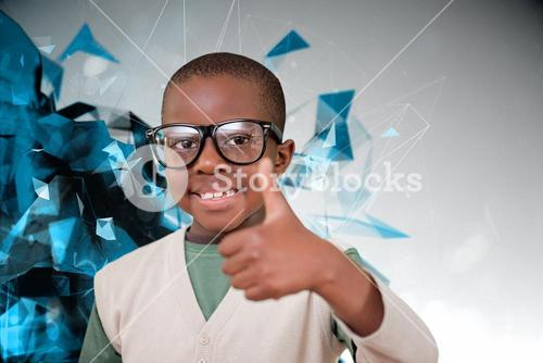 Composite image of cute pupil with thumbs up