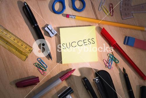 Success against students table with school supplies