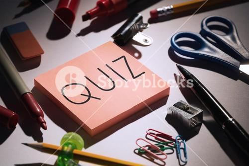 Quiz against students table with school supplies