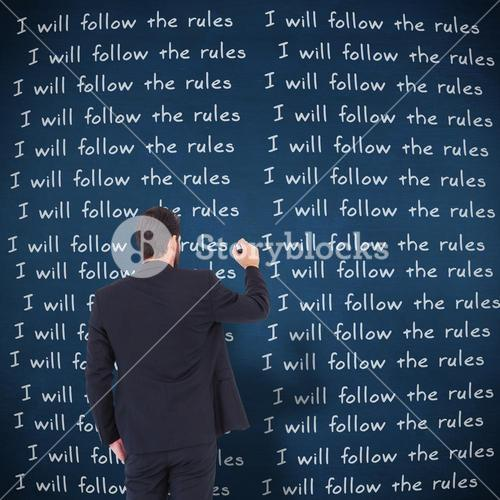 Composite image of businessman in suit writing with marker