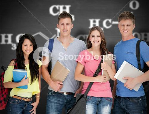 Composite image of students looking at the camera as they hold notepads