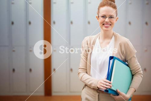 Composite image of teacher with books