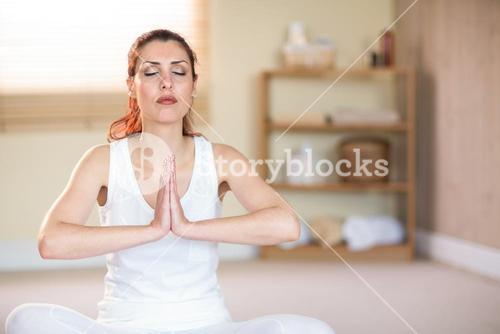 Woman meditating with joined hands
