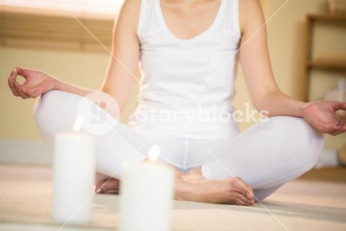 Low section of woman meditating