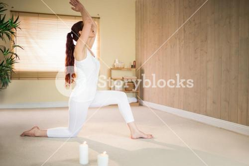 Side view of woman meditating with joined hands