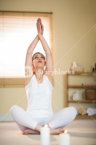 Woman in yoga pose with hands joined