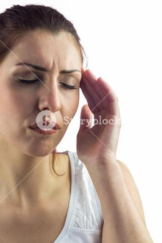 Woman with eyes closed and suffering from headache