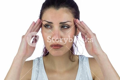 Stressed woman suffering from headache