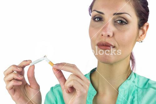 Close-up portrait of woman breaking cigarette