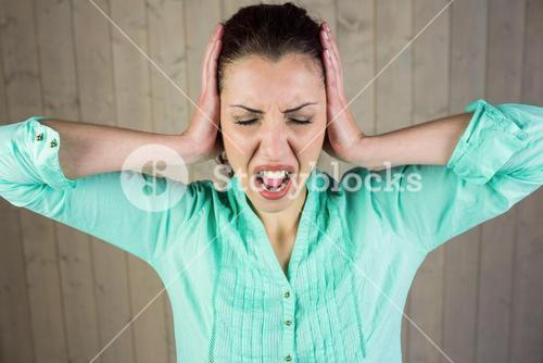 Woman with eyes closed while suffering from headache