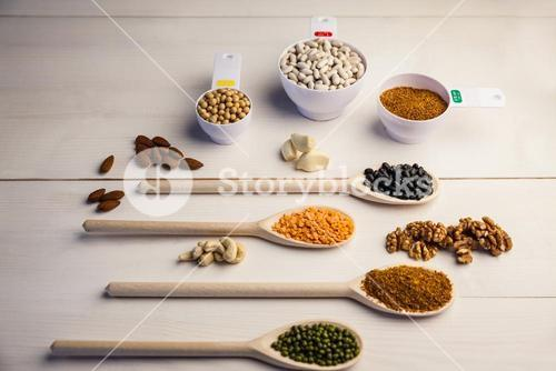 Spoons and cups of pulses and seeds