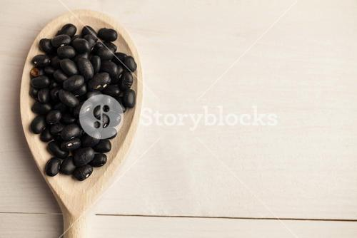 Wooden spoon of black beans