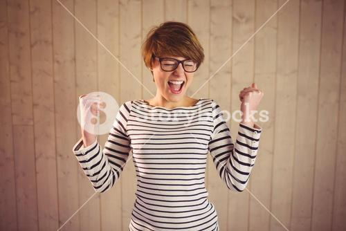 Attractive young woman celebrating victory