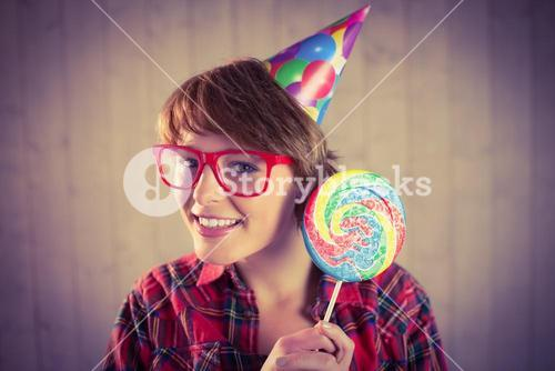 Pretty woman with lollipop and hat party