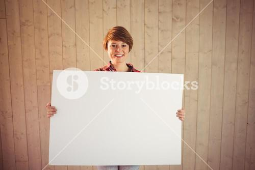 Pretty young woman holding sign